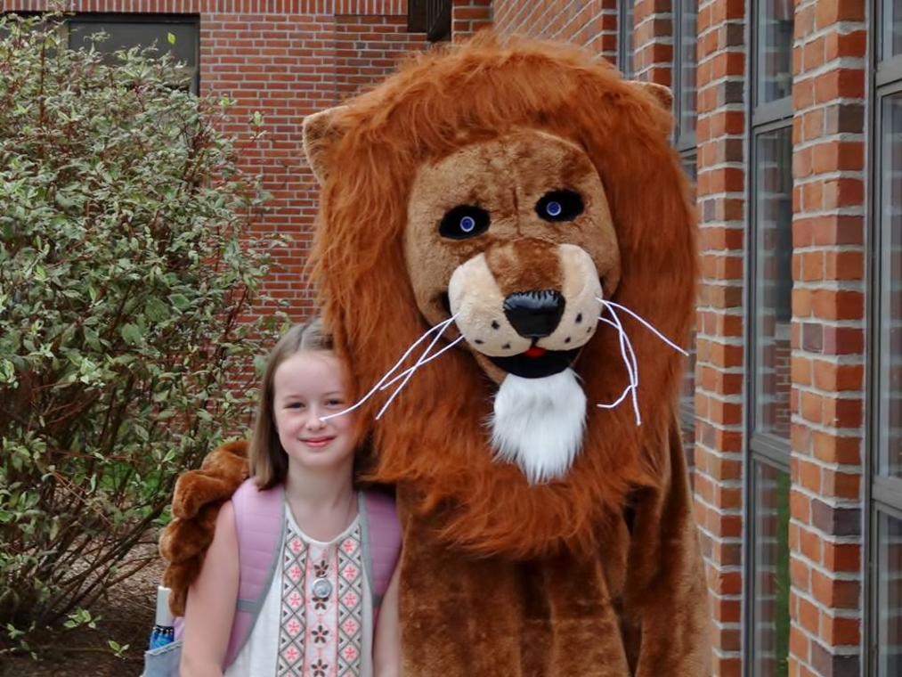 First day of school student with mascot