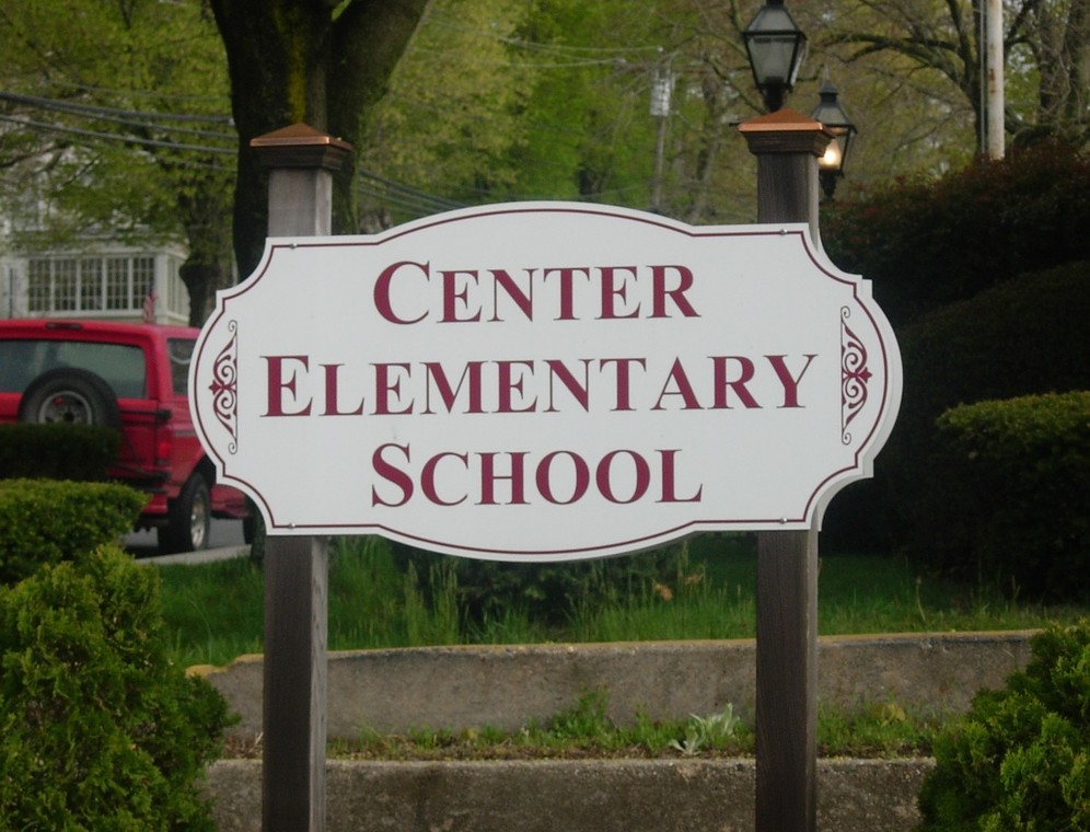 sign at entrance of school driveway